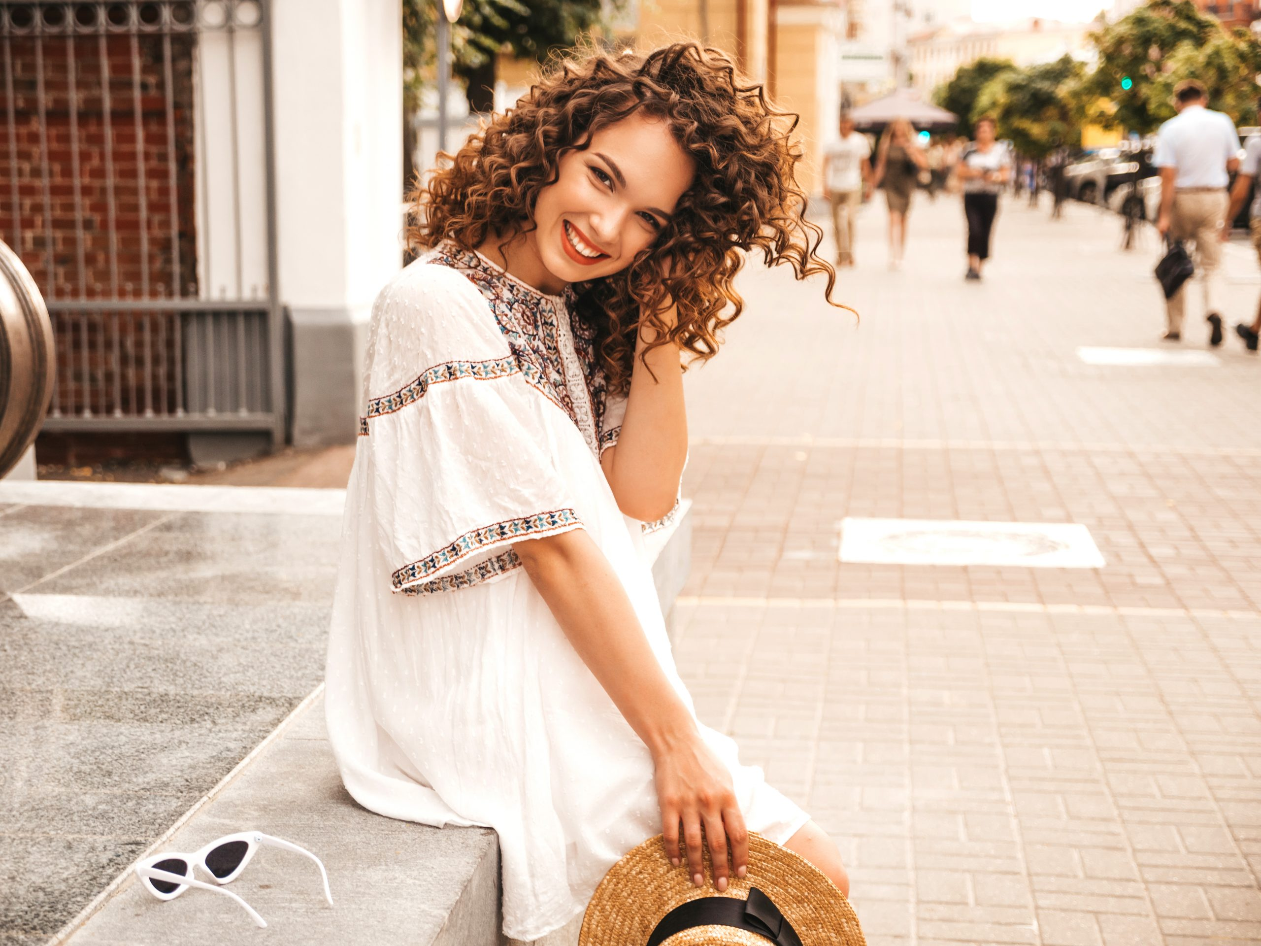 Beautiful smiling girl with afro curls hairstyle